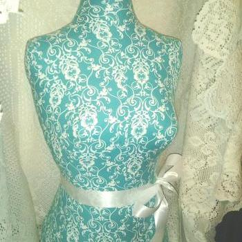 Decorative Dress form designs with stand, life size torso great for store front display or home decor. Teal scroll print.